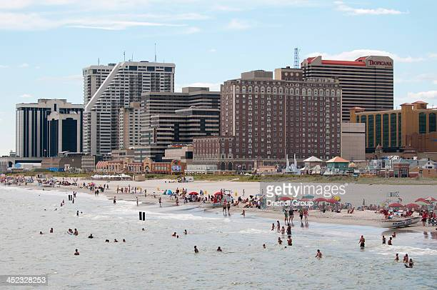 atlantic city skyline with tourists on the beach. - atlantic city stock pictures, royalty-free photos & images