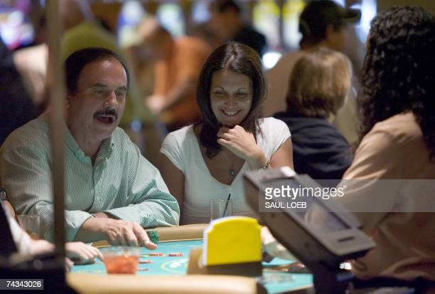Atlantic City, UNITED STATES: Visitors play poker at the Borgata Hotel Casino and Spa in Atlantic City, New Jersey, 25 May 2007. The hotel, which...