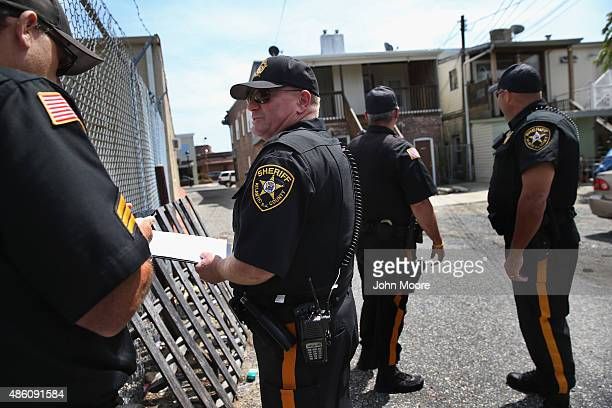 Atlantic County Sheriff's office deputies prepare to evict tennants during foreclosure proceedings in Pleasantville Atlantic County New Jersey The...