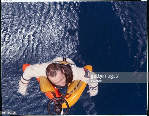 Atlantic Ocean Astronaut Ed White is hauled aboard helicopter June 7th following splashdown in the Atlantic which terminated historic Gemini IV space...