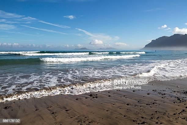 Atlantic Ocean coast beach and waves, Caleta de Famara, Lanzarote, Canary islands, Spain.