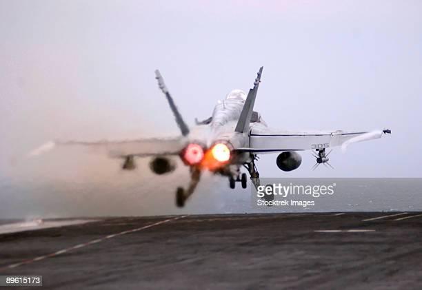 Atlantic Ocean, March 10, 2006 - An F/A-18C Hornet launches from the flight deck of the Nimitz-class aircraft carrier USS Theodore Roosevelt (CVN-71).