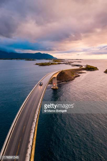 atlantic ocean road at sunset, norway - ノルウェー文化 ストックフォトと画像