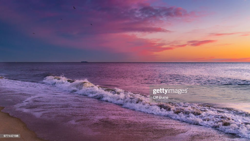 Atlantic Ocean waves at sunrise, Delaware, USA : Stock Photo