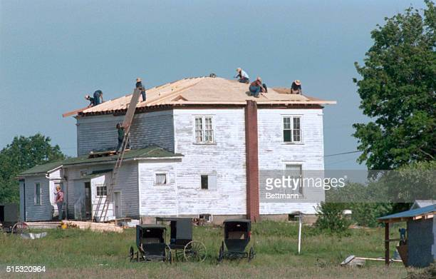 Atlantic Pennsylvania Amish men work to replace roof of an Amish man's home which was blown off by tornado in storm which hit this tiny Crawford...