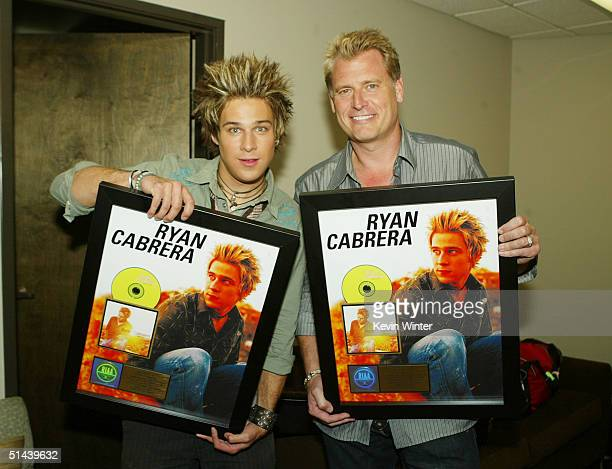 """Atlantic recording artist Ryan Cabrera and his manager Joe Simpson were presented with gold records after Cabrera performed on """"The Tonight Show with..."""
