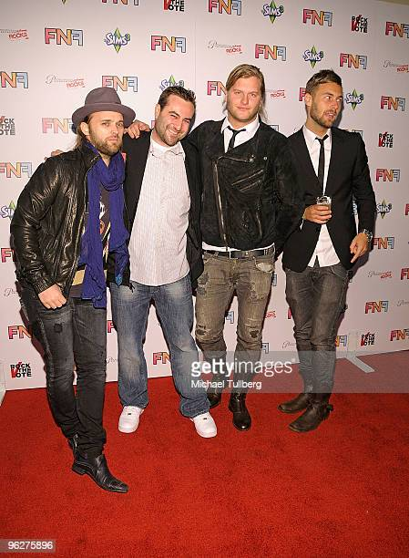 Atlantic Records VicePresident Kevin Weaver arrives with musicians Johann Carlsson Chad Wolf and Rickard Goransson of the band Carolina Liar at the...