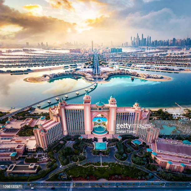 atlantis hotel at the palm jumeirah island in dubai united arab emirates aerial view - tourism stock pictures, royalty-free photos & images
