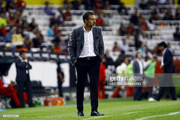 Atlas' coach Gustavo Matosas looks on during their Mexican Apertura 2015 tournament football match against Toluca at Jalisco stadium on August 22...