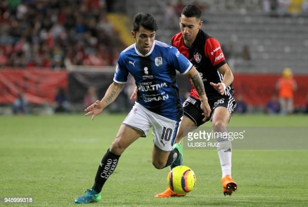 Atlas´ defender Ismael Govea vies for the ball with Queretaro´s forward Edson Puch during their Mexican Clausura 2018 tournament football match at...
