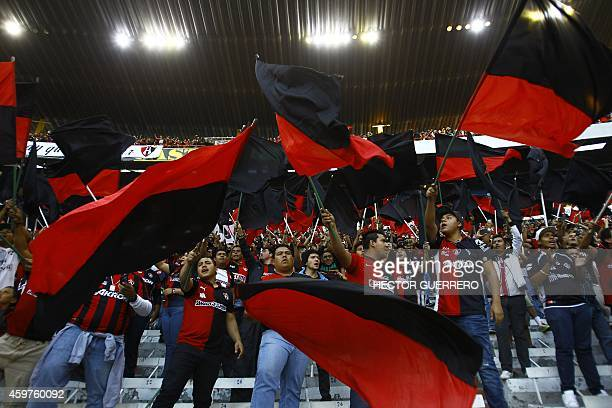 Atlas' fans flutter flags during a 2014 Mexican Apertura tournament football match against Monterrey in Guadalajara Mexico on November 30 2014 AFP...