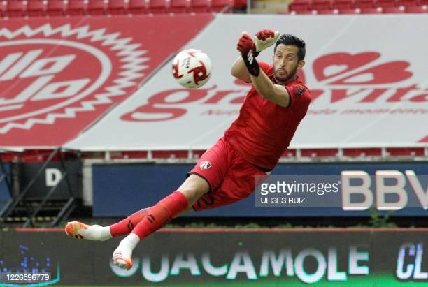 Atlas' goalkeeper Camilo Vargas pulls off a save during the Copa por Mexico pre-season football tournament match against Tigres, at the Akron stadium...