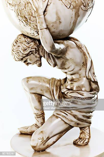 atlas statue  - mythological character stock photos and pictures