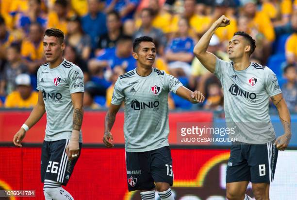 Atlas's Andres Andrade celebrates after scoring against Tigres during the Mexican Apertura 2018 tournament football match at the Universitario...