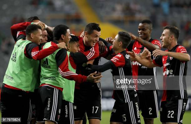 Atlas's forward Milton Caraglio of Argentina celebrates with teammates after scoring a goal against Necaxa during their Mexican Clausura 2018...