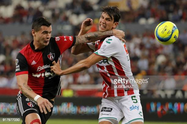 Atlas's forward Milton Caraglio of Argentina vies for the ball with Necaxa's defender Igor Lichnovsky of Chile during their Mexican Clausura 2018...