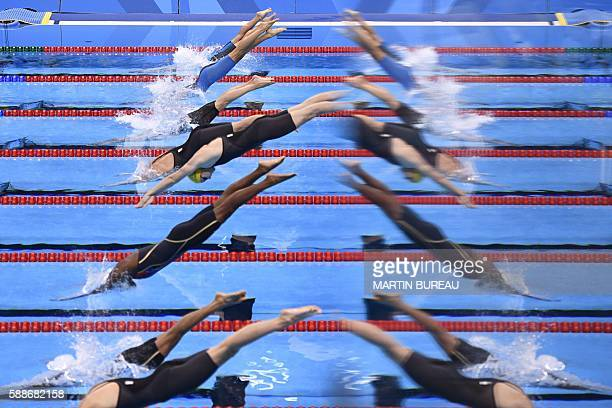 TOPSHOT Atletes are mirrored in a window during the Women's 50m Freestyle heats at the swimming event at the Rio 2016 Olympic Games at the Olympic...