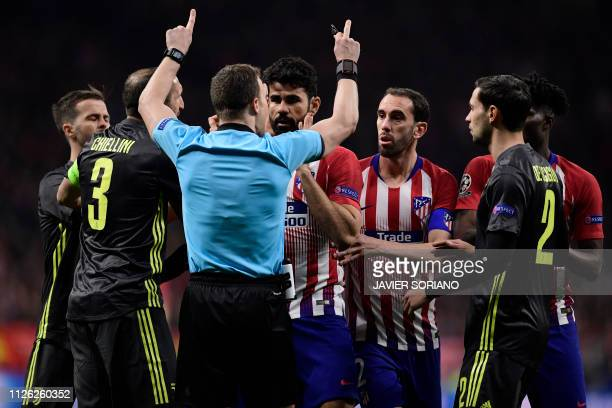 Atletico and Juventus players protest to German referee Felix Zwayer during the UEFA Champions League round of 16 first leg football match between...
