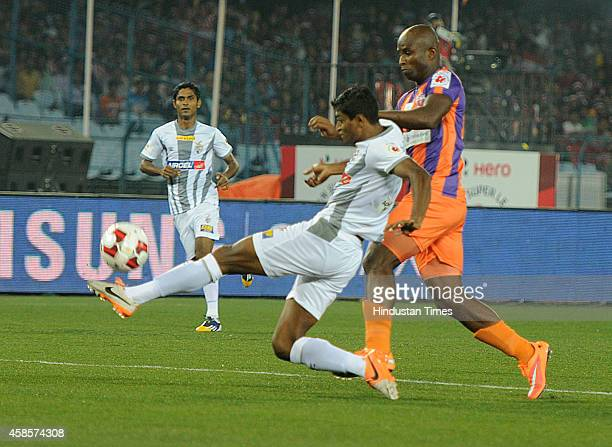 Atletico de Kolkata and FC Pune City players in action during their ISL match at Salt Lake Stadium on November 7 2014 in Kolkata India FC Pune City...