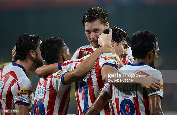 Atletico de Kolkata defender Henrique Fonseca Sereno celebrates after he scores a goal against Kerala Blasters FC during the final Indian Super...