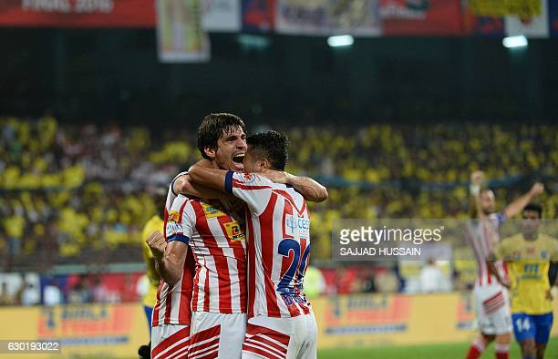 Atletico de Kolkata defender Henrique Fonseca Sereno celebrates after he scored a goal against Kerala Blasters FC during the final Indian Super...