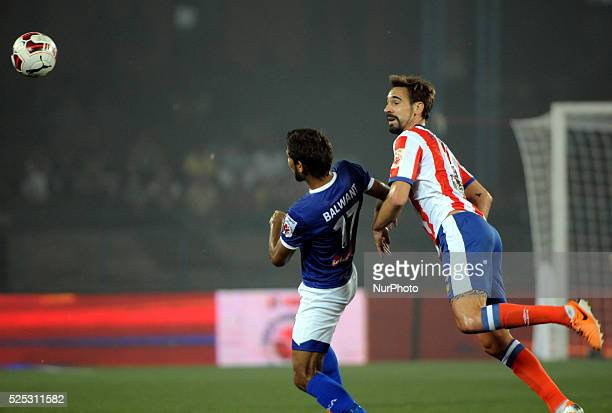 Atletico de Kolkata footballer Borja Fernandez and Chennaiyin FC footballer fight for the ball as others look on during the Indian Super League...