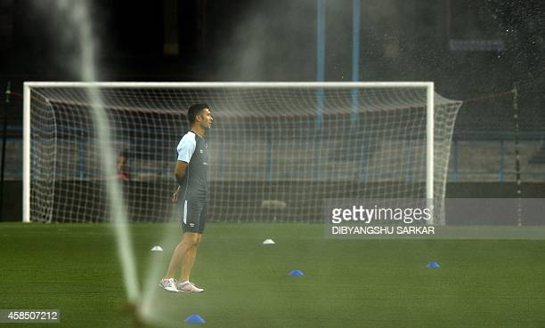 Atletico De Kolkata footballer Luis Garcia warms up during a training session on the eve of their match against Pune City FC of the Indian Super...