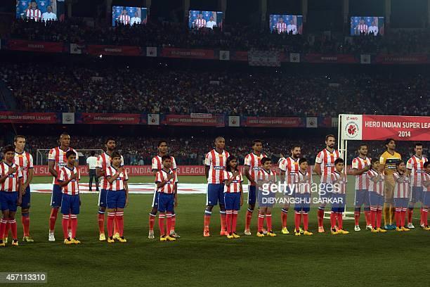 Atletico de Kolkata footballers observe the Indian national anthem prior to the Indian Super League football match between Atletico de Kolkata and...