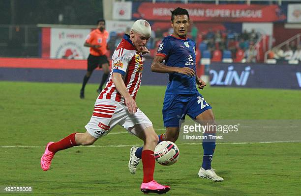 Atletico De Kolkata player Iain Hume trying to go past the Mumbai City FC defender Fanai during Indian Super League match at DY Patil stadium on...
