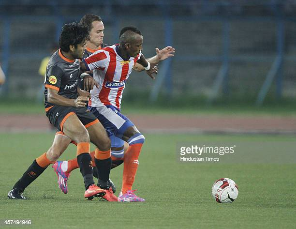 Atletico De Kolkata player in action defending Delhi Dynamos FC player during ISL match at The Salt Lake Stadium Kolkata India on Sunday October 19...