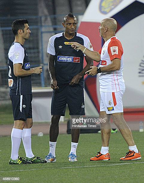 Atletico de Kolkata players Luis Garcia and Fiku having discussion with coach Antonio Habas during practice ahead of their match against visiting...