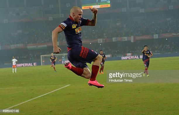Atletico De Kolkata striker Iain Edward Hume celebrates after scoring 2nd Goal during the ISL match against FC Pune City at Salt Lake Stadium on...