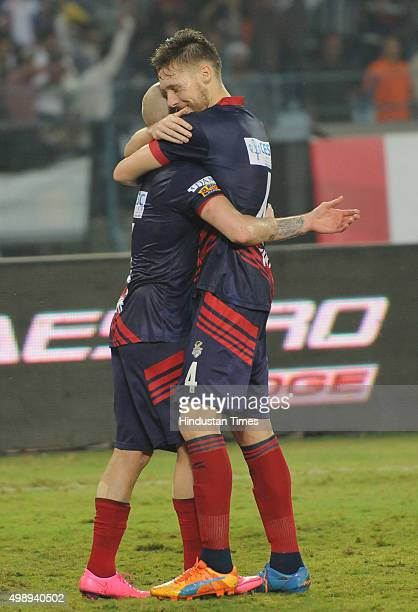 Atletico De Kolkata striker Iain Edward Hume celebrates with teammate Tiri after scoring goal during the ISL match against FC Pune City at Salt Lake...
