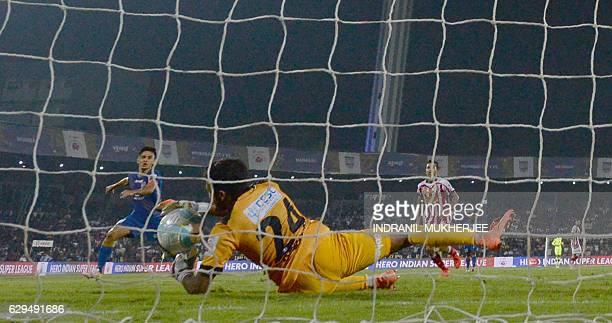Atletico de Kolkata's goalkeeper Debjit Majumder saves a shot from Mumbai FC's forward Sunil Chhetri during the Indian Super League second leg...