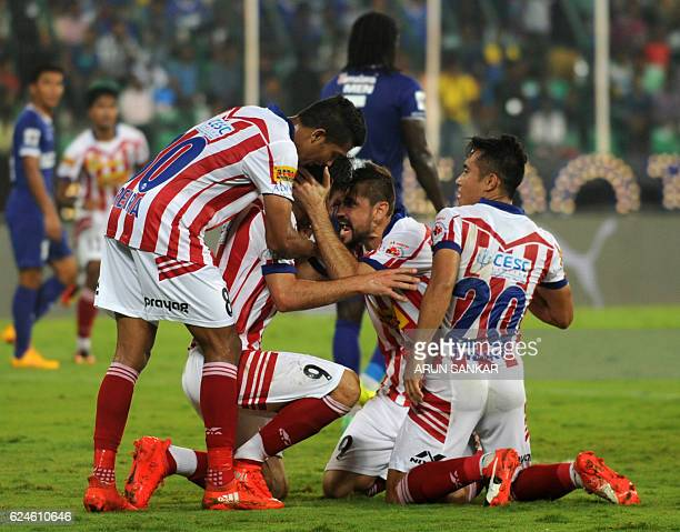 Atletico De Kolkata's Helder Manuel Postiga celebrates with teammates after scoring a goal against Chennaiyin FC during the Indian Super League...