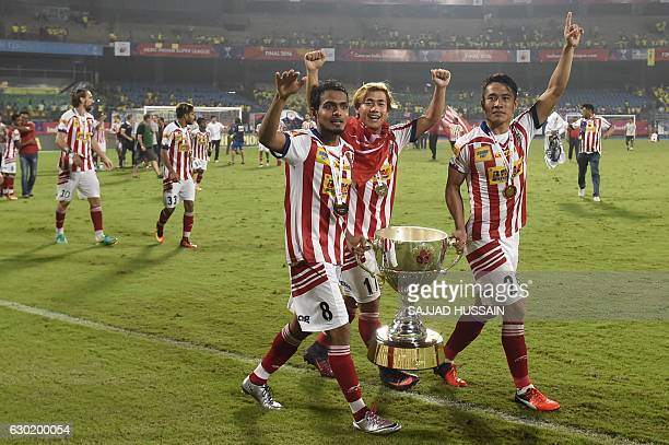 Atletico de Kolkata's Jewel Raja Shaikh Atletico de Kolkata's midfielder Bidyananda Singh Lalrindika Ralte celebrate with the trophy after winning...