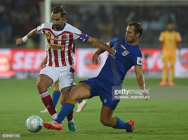 Atletico de Kolkata's midfielder Borja Fernandez controls the ball against Mumbai FC's midfielder Krisztian Vadocz during the Indian Super League...