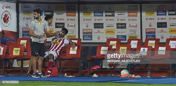 Atletico de Kolkata's support staff tends to an injured player after a scuffle at the end of the Indian Super League second leg semifinal football...