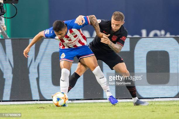 Atletico de Madrid defender Kieran Trippier and Chivas de Guadalajara forward Alexis Vega battle for the ball during the International Champions Cup...