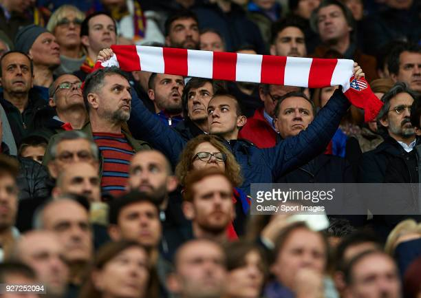 Atletico de Madrid fan holds up a scarf in the crowd during the La Liga match between FC Barcelona and Atletico de Madrid at Camp Nou on March 4 2018...