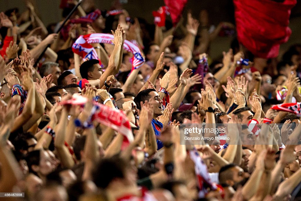 Atletico de Madrid fans celebrate their goal during the UEFA Champions League group A match between Club Atletico de Madrid and Juventus at Vievnte Calderon Stadium on October 1, 2014 in Madrid, Spain.