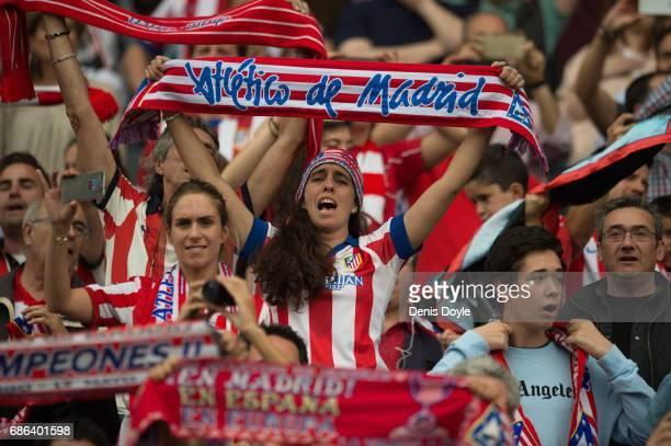 Atletico de Madrid fans cheer their team during the La Liga match between Club Atletico de Madrid and Athletic Club Bilbao at Vicente Calderon...