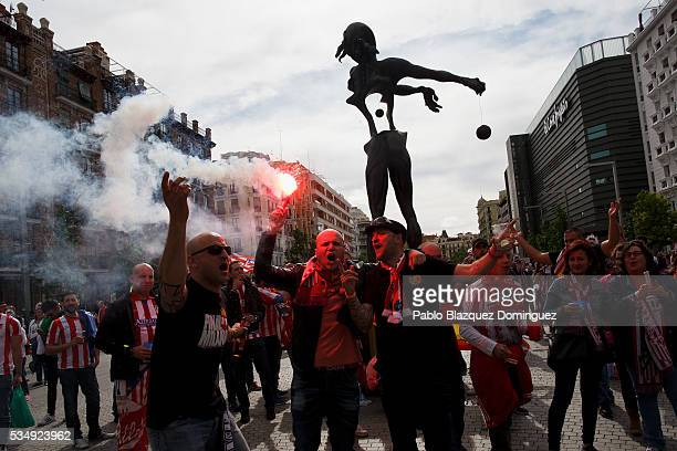 Atletico de Madrid fans cheer their team outside the Barclaycard Center before the UEFA Champions League Final match between Real Madrid CF and Club...