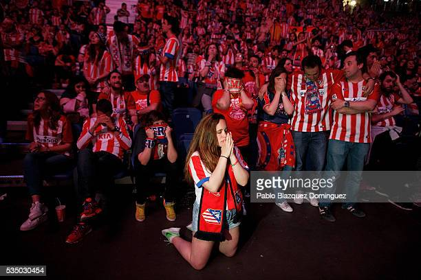 Atletico de Madrid fans react during the penalties during the UEFA Champions League Final match between Real Madrid CF and Club Atletico de Madrid at...