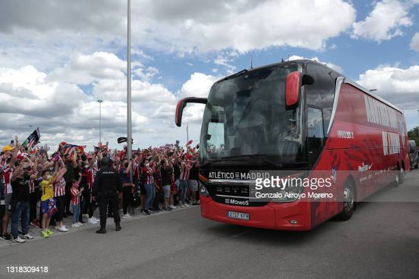 Atletico de Madrid fans welcome the team coach as the players arrive at the stadium prior to the La Liga Santander match between Atletico de Madrid...