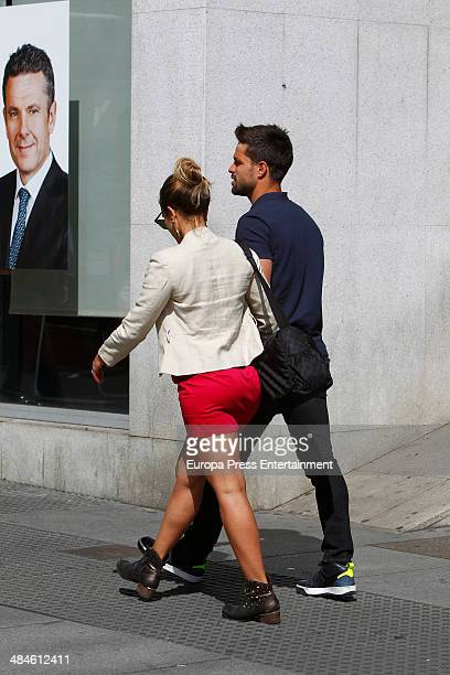 Atletico de Madrid football player Diego Ribas and his wife Bruna Leticia are seen on April 11 2014 in Madrid Spain