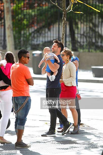 Atletico de Madrid football player Diego Ribas his wife Bruna Leticia and sons are seen on April 11 2014 in Madrid Spain
