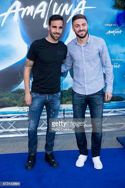 Atletico de Madrid football players Jesus Gamez and Guilherme Siqueira attend the 'Cirque Du Soleil' photocall on May 7 2015 in Madrid Spain