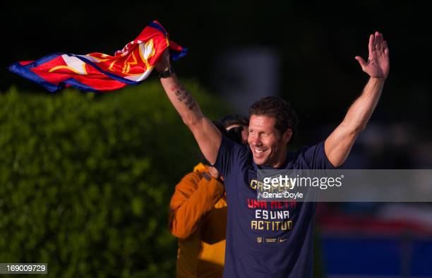 Atletico de Madrid head coach Diego Simeone waves to supporters during celebrations a day after winning the Copa del Rey Final against Real Madrid on...