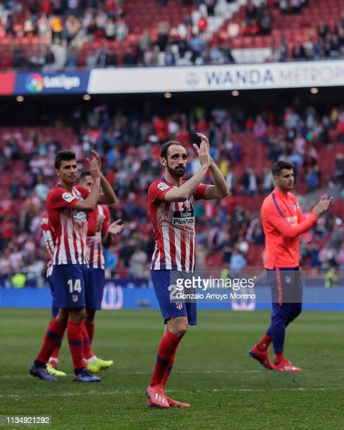 Atletico de Madrid players Angel Martin Correa , Rodrigo Hernandez and Alvaro Morata acknowledges the audience after winning the La Liga match...